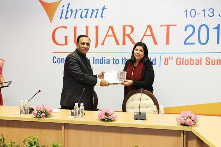 AIBC National Chair Sheba Nandkeolyar receiving a presentation from Chief Minister of Gujarat, Shri Vijaybhai R. Rupani